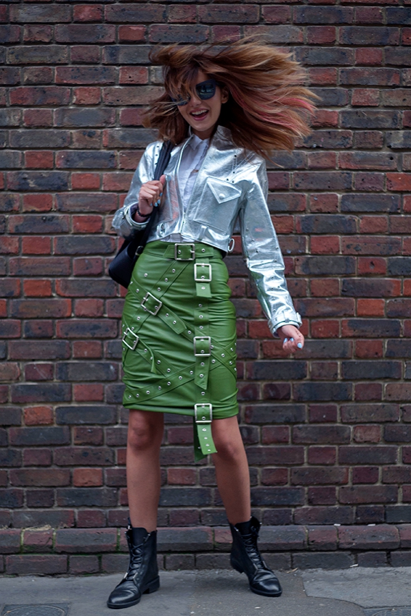 Street style from day five of London Fashion Week SS 2017 on Tuesday 20th September 2016. Image shows Luana Cudreanu, Editor of fashion blog and Instagram LastMinuteCouture. She wears a buckled green leather strapped skirt with a silver jacket, both by Concepto, with Zara boots and Philip Lim sunglasses.